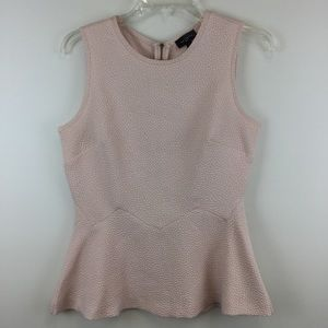 The limited light pink sleeveless blouse